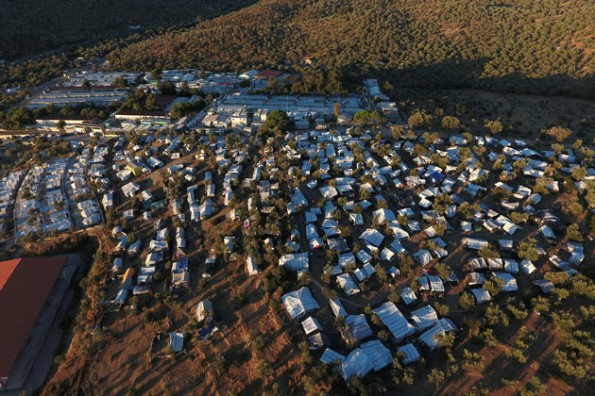 A view of the Moria camp for refugees and migrants and a makeshift camp set next to Moria, on the island of Lesbos
